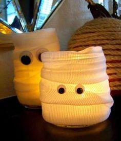 Cassie of Hi Sugarplum! used Mason jars she already had on her table, dollar store gauze, and googly... - Hi Sugarplum!