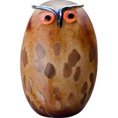 Birds by Toikka Uhuu: The individually handmade, mouth blown glass Uhuu is a big fun bird with its oblong body and vibrant eyes. Made of marbled brown glass, the Uhuu is a standout in the extensive bird collection created by Oiva Toikka since