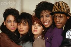 """1988 --- The original cast of the television show """"A Different World"""": Lisa Bonet, Jasmine Guy, Dawnn Lewis, Marisa Tomei, and Kadeem Hardison. Aired: 1987-1993. --- Image by © Lynn Goldsmith/Corbis"""