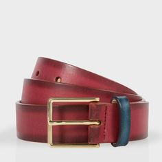 Paul Smith men's damson burnished leather suit belt with a contrasting black leather keeper. Made in Spain, this belt is finished with an Italian-made, pale gold plated Paul Smith signature embossed buckle.