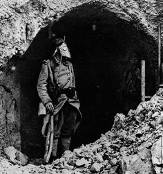 A French soldier at the Battle of Verdun, wearing a gas mask, 1916. Keystone
