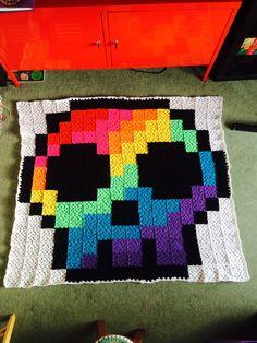 Crochet pixel skull blanket.