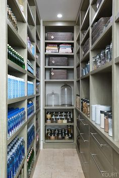 Open wood shelving and deep drawers with modern hardware make the most of this panytry in Kourtney Kardashian's house.