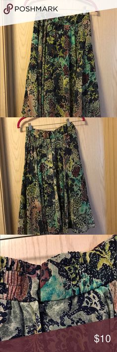 Beautiful printed  multi color small skirt In good condition. Zipper at back see pics Skirts Midi