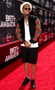 Chris Brown from 2015 BET Awards: Red Carpet Arrivals  The singer pulls off a suave, summery look featuring a floral-print jacket, cropped black pants and a cream-colored topper.