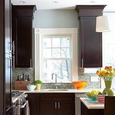 dark kitchen cabinets with blue walls and backsplash! by GemmaMarie