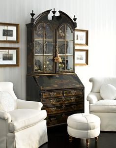 Eva Quateman's Chicago apartment includes an antique chinoiserie secretary in front of an ottoman she designed.