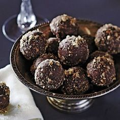 Bourbon Balls function as the ultimate easy dessert for Southern cocktail parties, and they put a sweet, slightly boozy finish on any get-together. Think of them as an edible digestif. Crushed vanilla wafers hold all the chocolatey goodness together. Buy an 11-ounce box and remove two dozen wafers to save for another use, like Banana Pudding.