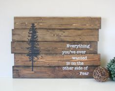 Gratitude turns what we have into enough Lovely daily reminder to give thanks for all that we have.. Gratitude brings us all more abundance to our lives. This sign measures 10.  X 30 and is stained in a dark walnut, red stripe on one of the boards and distressed for that rustic charm then hand painted in ivory/white lettering. I am able to change the color of the stripe if you desire, please just send me a message.  All of my signs are made from reclaimed wood or repurposed wood. With using…