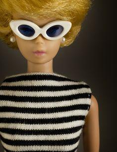 Blonde bubblecut Barbie in her famous sunglasses