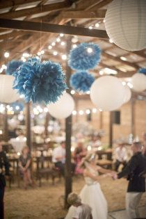 Mixture of pompoms and round paper lanterns for wedding decor ideas - www.lightalantern.co.za if you looking to find this in South Africa.