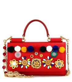 Dolce & Gabbana - Sicily Von Bag embellished leather smartphone shoulder bag - Dolce & Gabbana blurs the lines between phone case, wallet and shoulder bag with the inventive 'Sicily Von Bag' piece. The red leather style is adorned with eye-catching pompoms, mirrors and crystals for a dazzling effect. Just the right size for your after-dark essentials, this piece will make a striking plus-one at your next party. seen @ www.mytheresa.com