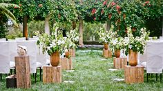 White flowers with wood vases by Beth Helmstetter