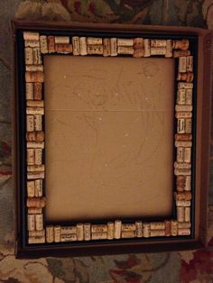 Wine cork chalkboard DIY, part 1. Saved all the corks from all the bottles of wine Alex and I have shared over the years. Then attached them to a thick, black wooden frame. Next up, attaching the chalkboard I painted.