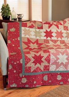 Gather 24 red fat quarters and 24 cream fat quarters; then fall in love making this Rugby Stars quilt by Gerri Robinson
