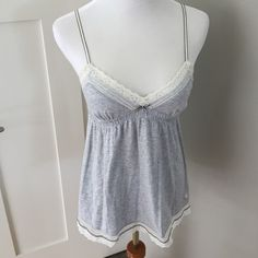 AE Adorable Cotton Babydoll Tank Adjustable straps, lace and ribbon detail. Great summer top! (minor pilling and yellowing on lace. Not noticeable when worn- price reflects) American Eagle Outfitters Tops Tank Tops