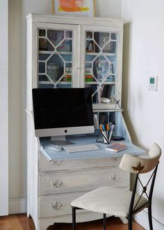 A white and black French desk chair sits in front of a white French secretary desk accented with a blue interior and fitted with a pull down desk top and glass front cabinets. Vintage Bookshelf, Interior Design Awards, Secretary Desks, White Secretary Desk, Home Office Furniture, Furniture Online, Dorm Furniture, Urban Furniture, Apartment Furniture