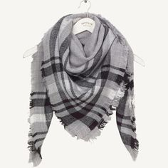 As cosy as a soft hug, this scarf is an effortless way to cheer up chilly necks. It'll look great worn over the warmest coat you can find in your wardrobe.