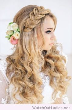Elegant wedding hair with braid and flowers