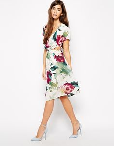 Love Floral Print Midi Dress with Cut Out Detail - How gorgeous is this dress? I usually go for a bodycon cut-out dress – but this midi skater style looks super lush! Must-have holiday item :) http://asos.to/1olVx34