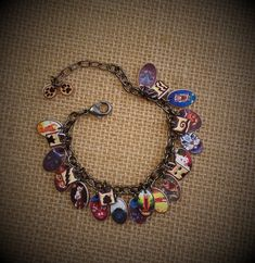 Warrior Cats - Warrior Cats Jewelry - Warrior Cats Bracelet - Warrior Cats Charm Bracelet - Warrior Cat Characters - Warrior Cat Clan Charms - Young Reader - Warrior Cats Books - Boy - Girl - Warrior Cats Fan - Reader - Charm Bracelet - FSABR0001  The Warrior Cats are a popular book series for pre-teens and teens alike.  This unique bracelet, loaded with charms, fills the bill for any serious Warrior Cats fan. What a wonderful idea as a gift for your Warrior Cats lover! It is sized to fit…