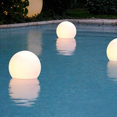Pretty pool floats that glow, from Cerise sur la Deco
