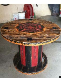 Wooden Spool FireFighter table *Similar* Firefighter Home Decor, Firefighter Family, Volunteer Firefighter, Firefighters, Firefighter Wedding, Fire Hose Projects, Wood Projects, Fire Hose Crafts, Spool Tables