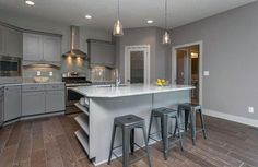 Contemporary+kitchen+with+gray+flat+panel+cabinets,+gray+backsplash+tiles+and+white+granite+counter