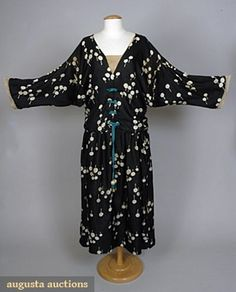 Paul Poiret dress, 1921 Black China silk w/ white stylized lollipop print 2-piece day dress, underskirt w/ attached silk undershirt, top w/ dolman sleeves, crochet bauble trim, turquoise gros-grain ribbons & celluloid tassels.  This dress sold at auction for just under 15K