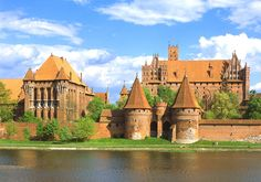 Castle of the Teutonic Order in Malbork, Photo by: B. Read more about Polish UNESCO World Heritage Sites at: Malbork Castle, Brick Art, The Real World, World Heritage Sites, Barcelona Cathedral, Castles, Poland, Places To See, Architecture Design