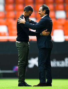 Head coach Cesare Prandelli (L) of Valencia CF and Head coach Luis Enrique of FC Barcelona shake hands prior to the La Liga match between Valencia CF and FC Barcelona at Mestalla stadium on October 22, 2016 in Valencia, Spain.