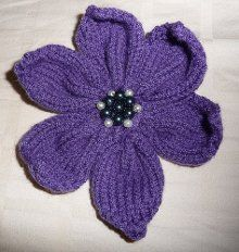 Easily embellish your knit sweaters, afghans, scarves and more with this 6 Petal Flower.  The free knit flower pattern is created by knitting 6, same sized petals separately.  To assemble, simply sew the petals together starting at the base.