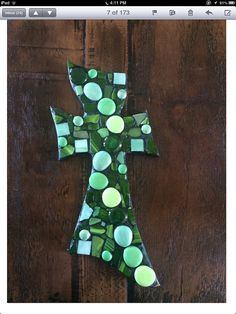 Green cross wall hanging, measures 19 inches tall and 8 inches wide.