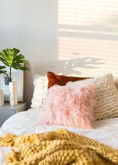 Try this idea for making a fluffy, cozy edition to your couch or bed. Using one of your pre-existing throws and one simple hack, you can now turn that unused blanket into a cute and budget-friendly piece of decor, thanks to our step by step guide.