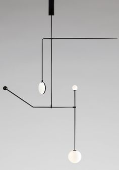 MICHAEL ANASTASSIADES, Mobile Chandelier nr.6, 2015. Material black patinated brass, mouth blown opaline spheres.