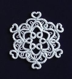 "This snowflake is a modified version of ""Anne"" from Jennifer Williams' new book ""Tatted Snowflakes"". A lovely birthday present (yay! Tatting Necklace, Tatting Jewelry, Tatting Lace, Doily Patterns, Crochet Patterns, Dress Patterns, Needle Tatting Patterns, Tatting Tutorial, Jennifer Williams"