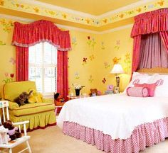 Brilliant yellow walls host a virtual flower garden of posies. Formal draperies and curved valances gain a more playful look when fashioned from brightly patterned fabrics.