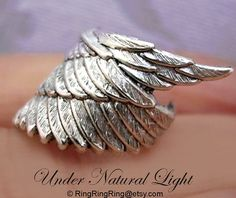 925, Archangel wing - solid Sterling silver ear cuff earring jewelry - Angel wing style No.1, non pierced  Earcuff for men and women 091612. $45.00, via Etsy.