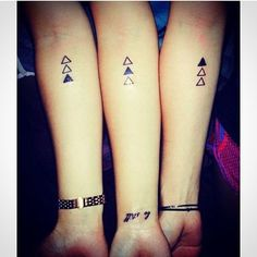 This is such a good idea for sister tattoos. We could even do something simpler like string of circles. I personally love the triangle though.