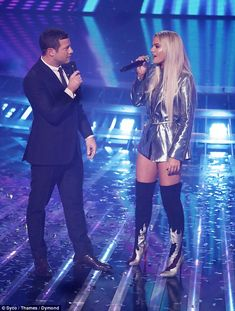 Weighing in: As she stood among the tumbling silver confetti she beamed as she spoke to host Dermot O'Leary about her favourites