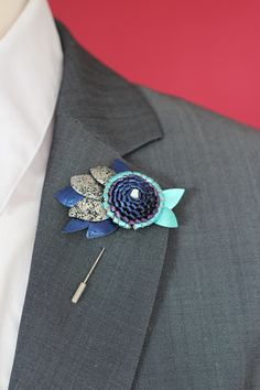 A personal favourite from my Etsy shop https://www.etsy.com/listing/238970596/peacock-leather-lapel-pin-mens-lapel-pin