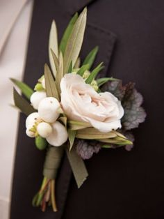 Fav one -  White spray roses and white snowberries wrapped in ivory ribbon with the stems showing