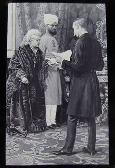 Queen Victoria with her personal Indian servant, Abdul Karim, who was her companion and secretary during her last years.  It is said that her children were jealous of Victoria's affection for Abdul, whom she called Munshi.  He returned to India upon Queen Victoria's death.