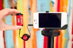 """The iPhone Cable Trigger - Perfect for the phoneography enthusiast, who still has a soft spot for film.    It's a cable shutter release for iPhones that has an addictively clickable button. No more jabbing at that on-screen """"button!"""" $23"""