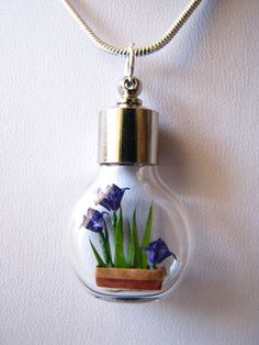 Tiny origami irises in a necklace.  So pretty.