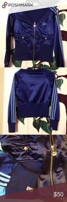 "Adidas Respect M.E. By Missy Elliot. Cropped track jacket, gently worn, in mint condition. Navy blue with powder blue stripes and crown. Has gold buttons along with crown zipper. Dimensions are 24"" from top of collar to bottom, arm pit to arm pit 18"" and arm length 28"". Super cute but, it doesn't fit me  Adidas Jackets & Coats"