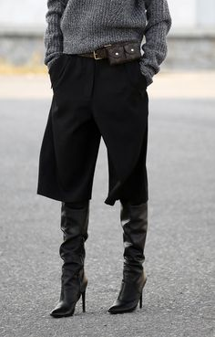 Fashion: Fall / Winter. Black culottes with black leather high boots.