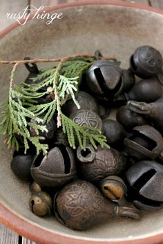 A wonderful bowl of old bells and hardware - add some pine and a splash of red for the Holiday's.