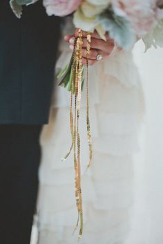 sequin strands hanging from a bouquet? sign us up!  Photography by taylorlordphotography.com, Floral Design by bowsandarrowsdeluxe.com