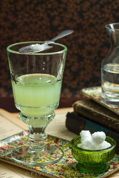 ... dissolves into the absinthe giving the drink an opalescent jade color